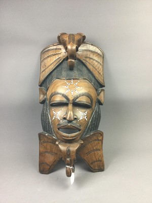 Lot 129 - A 20TH CENTURY AFRICAN CARVED WOOD WALL MASK
