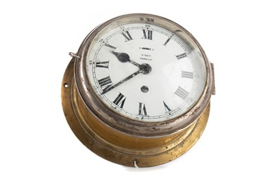 Lot 1127 - A BRASS CASED SHIP'S BULKHEAD CLOCK BY STORY OF BARROW