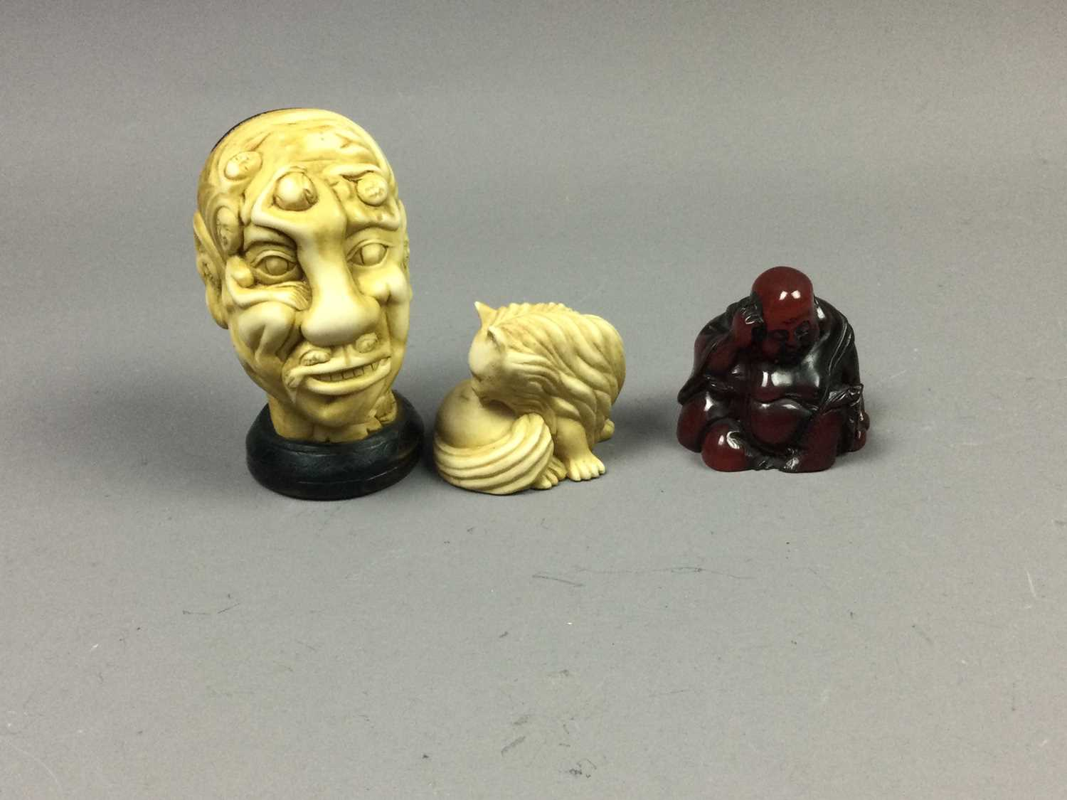 Lot 32 - A CHINESE NOVELTY RESIN HEAD STUDY ALONG WITH TWO RESIN NETSUKE