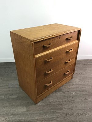 Lot 153 - A MID 20TH CENTURY OAK CHEST OF FOUR DRAWERS