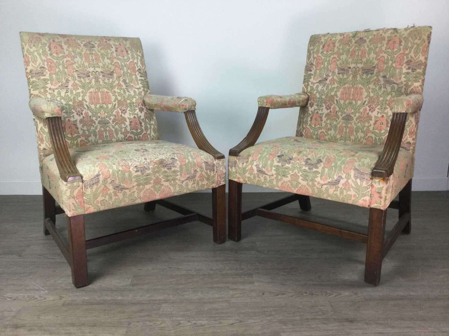 Lot 1367 - A PAIR OF GEORGE III MAHOGANY LIBRARY ARMCHAIRS