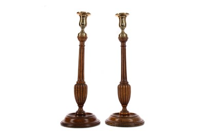 Lot 1348 - A PAIR OF GEORGE III STYLE OAK CANDLESTICKS
