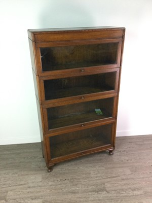 Lot 1350 - AN EARLY 20TH CENTURY BARRISTER'S OAK SECTIONAL BOOKCASE