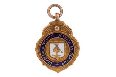 Lot 1748 - A GLASGOW JUVENILE FOOTBALL ASSOCIATION CUP GOLD MEDAL 1933/34