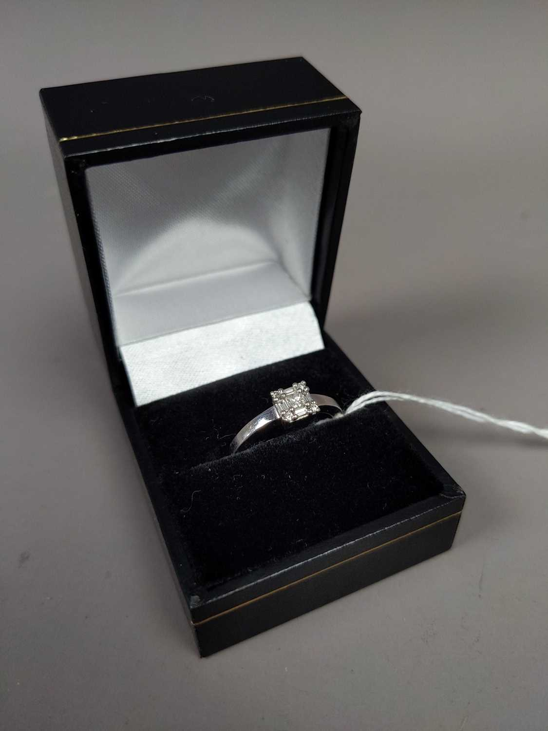 Lot 25 - A DIAMOND SOLITAIRE RING SET IN  NINE CARAT GOLD