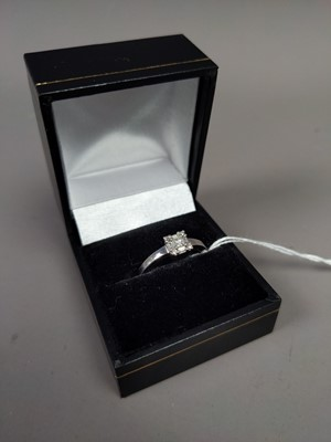 Lot 25A - A DIAMOND SOLITAIRE RING SET IN  NINE CARAT GOLD
