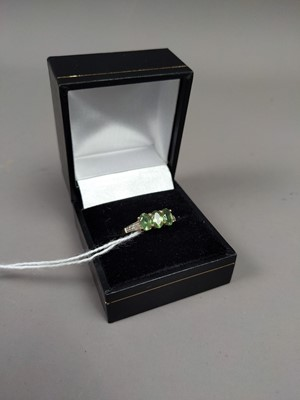 Lot 30A - A DIAMOND AND PERIDOT DRESS RING