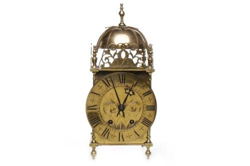 Lot 1030-EARLY 20TH CENTURY BRASS LANTERN CLOCK the...