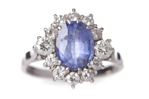 Lot 1-TANZANITE AND DIAMOND CLUSTER RING the central...
