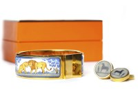 Lot 14-HERMES ENAMELLED BANGLE decorated with two...