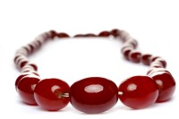 Lot 27-GRADUATED BAKELITE BEAD NECKLACE formed by beads...