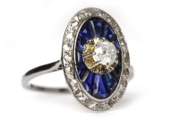 Lot 28-ART DECO SAPPHIRE AND DIAMOND RING of oval form,...