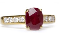 Lot 29-RUBY AND DIAMOND RING set with an oval cut ruby...