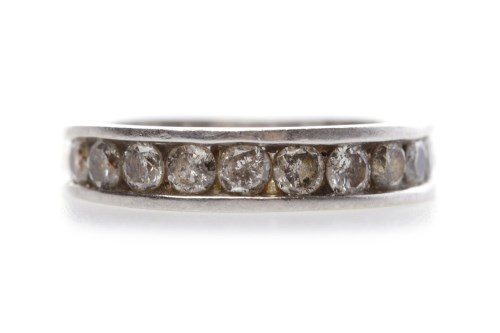 Lot 35-DIAMOND HALF ETERNITY RING with channel set round ...