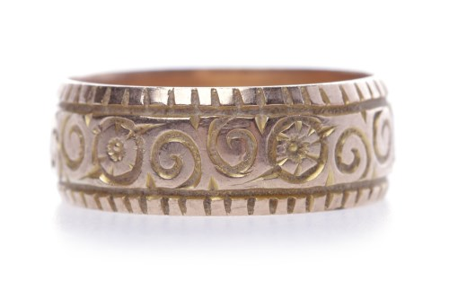 Lot 38-BROAD NINE CARAT GOLD ENGRAVED WEDDING BAND with...