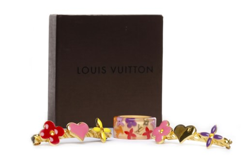 Lot 41-LOUIS VUITTON RING AND BARETTE SET the acrylic...
