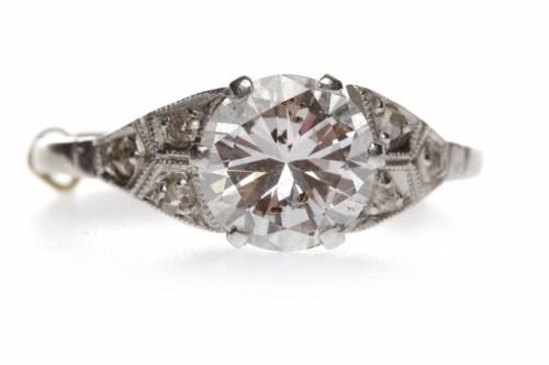 Lot 15-EARLY TWENTIETH CENTURY DIAMOND SOLITAIRE RING...