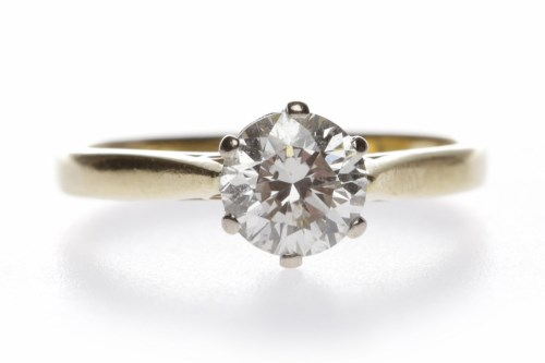 Lot 16-DIAMOND SOLITAIRE RING the six claw set round...