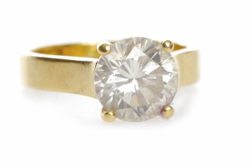 Lot 49-DIAMOND SOLITAIRE RING set with a round brilliant ...