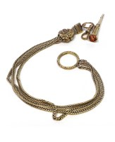 Lot 54-GOLD CHAIN WITH GEM SET APPENDAGE the curb link...
