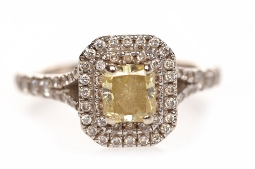 Lot 76-EIGHTEEN CARAT WHITE GOLD YELLOW AND WHITE...