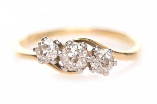 Lot 77-DIAMOND THREE STONE RING set with round brilliant ...