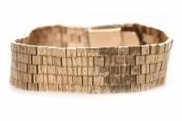 Lot 80 - NINE CARAT GOLD BRACELET formed by textured...