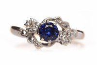 Lot 81-SAPPHIRE AND DIAMOND THREE STONE RING the central ...