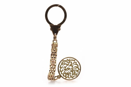 Lot 82 - GOLD KEYCHAIN with a decorative circular...