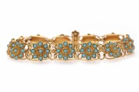 Lot 112 - HIGH CARAT GOLD TURQUOISE BRACELET formed by...
