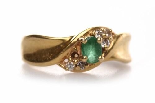 Lot 114 - EIGHTEEN CARAT GOLD EMERALD AND DIAMOND RING...