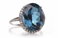 Lot 116 - TOPAZ AND DIAMOND DRESS RING set with a single...