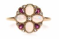 Lot 142 - RUBY AND OPAL DRESS RING the round bezel grain...