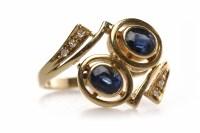 Lot 300 - EIGHTEEN CARAT GOLD SAPPHIRE AND DIAMOND DRESS...