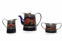 Lot 769-THREE PIECE MOORCROFT 'POMEGRANATE' PATTERN TEA...