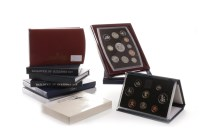 Lot 546-TEN UK AND OTHER PROOF COINS SETS including a...