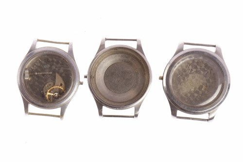 Lot 881 - THREE MILITARY ISSUE STAINLESS STEEL WATCH CASES