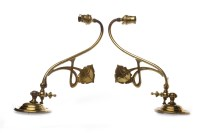 Lot 1257-PAIR OF GLASGOW SCHOOL BRASS WALL SCONCES of...