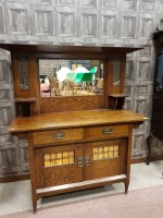 Lot 1266-ARTS & CRAFTS OAK MIRROR BACK SIDEBOARD the...
