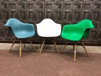 Lot 1280-EIGHT PLASTIC DAW ARMCHAIRS by designers Ray &...
