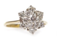 Lot 26-EIGHTEEN CARAT GOLD DIAMOND CLUSTER RING the...
