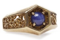 Lot 30-GENTLEMAN'S NINE CARAT GOLD STAR SAPPHIRE SET...