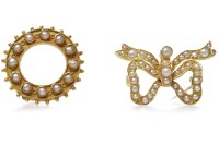 Lot 32-MID VICTORIAN PEARL SET BROOCH of open circular...
