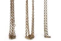 Lot 14-THREE NINE CARAT GOLD CHAINS each formed by rolo...