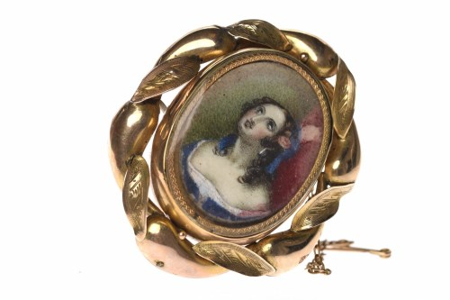 Lot 54-VICTORIAN PORTRAIT MOURNING BROOCH with a central ...