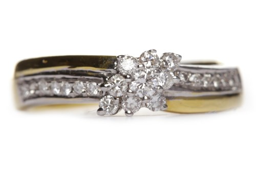 Lot 231-DIAMOND CLUSTER RING the marquise shaped bezel...