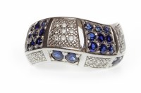Lot 29-UNUSUAL SAPPHIRE AND DIAMOND DRESS RING in the...
