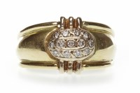 Lot 31-DIAMOND DRESS RING the broad tapered band with an ...