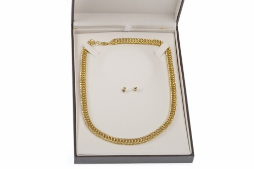 Lot 200-NINE CARAT GOLD NECKLET formed by double oval...