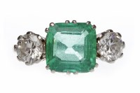 Lot 406-IMPRESSIVE EMERALD AND DIAMOND THREE STONE RING...